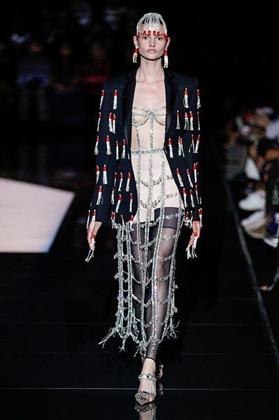 Schiaparelli- fringed suits clothing manufacturer